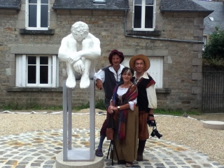 Sculptor Roger Vene (left) and friends
